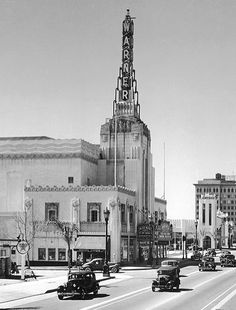 This is the Warner Bros. Theater, which stood on Wilshire Blvd at Canon Drive in Beverly Hills. That soaring tower with the art-deco-ish buttresses must have really stood out in the day. The theater was built in the early 1930s and demolished in the late 1980s. See more views of this palace on my website: http://www.martinturnbull.com/?p=6994
