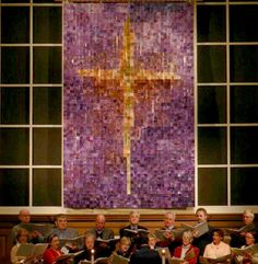 """Reassembling Our Brokenness"" Lenten Mosaic Banner at St. John's UMC in Memphis -  A collaborative art project, where church members, children, soup kitchen guests, and those involved in various mission areas painted on paper within a limited color palette, then the paper was punched into squares and rearranged, and taped together on the back with masking tape and duct tape."