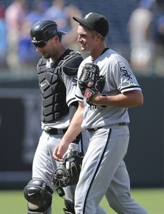 KANSAS CITY, MO - JULY 15: Addison Reed #43 and A.J. Pierzynski #12 of the Chicago White Sox walk off the field after their 2-1 win over the Kansas City Royals at Kauffman Stadium on July 15, 2012 in Kansas City, Missouri. (Photo by Ed Zurga/Getty Images)