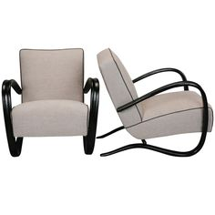 "Pair of Lounge Chairs by Jindrich Halabala  Czechoslovakia  1940s  Circa 1940s pair of lounge chairs by Czech designer Jindrich Halabala. Chairs have curvy black wood frames, low slanted seats and new upholstery in a gray linen blend tweed with black welting. Seats are 15"" high."