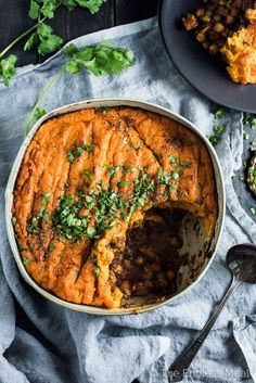 Vegan Shepherd's Pie has tons of flavor thanks to curry spices and caramelized tomato paste. It's loaded with veggies, lentils, and chickpeas and topped with coconut mashed sweet potatoes. It's a vegan dinner recipe that is as healthy as it is delicious.