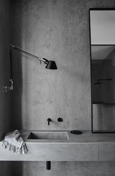 INSPIRATION: a moody concrete bathroom with black fixtures | est living