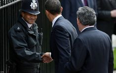The picture of a modern President: Obama shakes hands with a thrilled policeman outside Downing Street