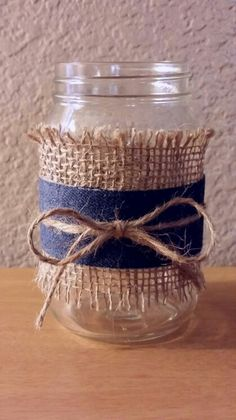 Dollar store mason jar, burlap, denim ribbon, and twine. So quick and easy to make.