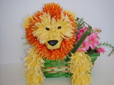 Lion. Floral animal arrangement made from silk flowers.  Website:  http://epetalsbyelizabeth.com/