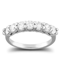 1.06 carat total weight anniversary ring features seven high grade round cut diamonds prong set in 14k white gold.