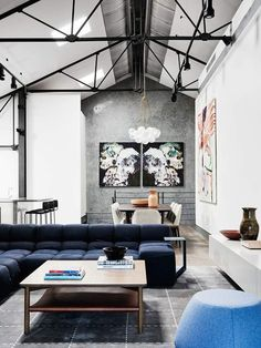 Love the loft life! Industrial can also have a more soft side.