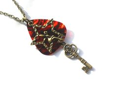 Bronze Fairy Guitar Pick Necklace . Starting at $6 on Tophatter.com!