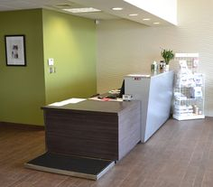 veterinary clinic design - Google Search - if we could find a way to put the scale beside the reception desk