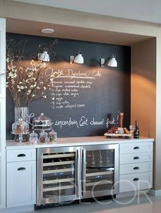 Built in Bar wall with the flower arrangement and the coolers. Would be great in a larger dining room sans chalkboard.