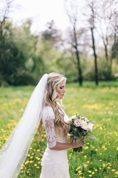 I love everything about this .. the hair, veil, dress, bouquet, pose..