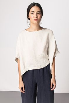 Love the loose pants with the asymetrical hem line on the shirt, and linen, I love linen.