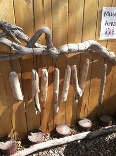 """A driftwood 'Musical Marimbra' - each piece of wood makes a different sound depending in the density of the wood. The drums at the bottom are made from coffee cans... from My Intentional Play ("""",)"""