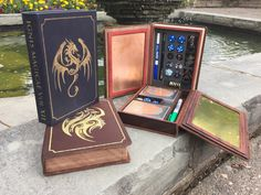 Gaming boxes built to look like arcane tomes! Rich leather, wood and metal come together in an elegant package that's functional & fun.
