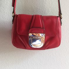 """Michael Kors handbag Red leather with gold hardware. No wear on this bag. Measures 5"""" x 8"""" x 2"""". Michael Kors Bags"""