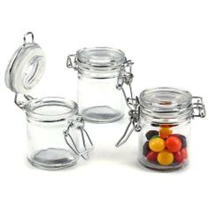 Kate Aspen 27037NA Glass Favor Jars by Kateaspen. $18.99. Glass jar has white-rubber gasket and metal locking device. Sold in a set of 12. Jar measures 1.75-inch by 2-1/2-inch including metal work. 40 pieces of small candy. Holds approximately 3.78 oz. Just like the classic, glass canisters you'll find in a contemporary kitchen, only smaller and sweeter! Fill the jars with a tasty treat, and treat your guests to a unique, miniature marvel--from the one and only Kate Aspe...