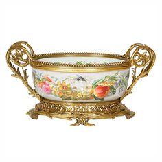 A gilt brass mounted oval porcelain jardiniere