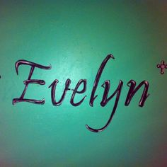 Used a projector to trace the name, then just painted it to make it look the way I wanted. Also painted some crosses on each side but could not fit the whole pic on here. This is on her wall above her bed.