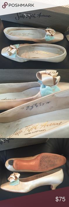 Vintage wedding shoes with original box! Silk flowers with bluish green velvet pedals adorn these beautiful wedding shoes. They come in the original box from Saks Fifth Avenue. They are a size 7 medium. Saks Fifth Avenue Shoes Heels