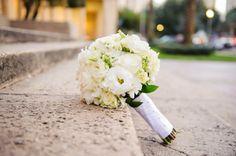 White and ivory wedding bouquet with fluffy cream roses and satin white wrap. Black Tie Museum of Fine Arts Modern Jewish Wedding | Modern Jewish Wedding Blog