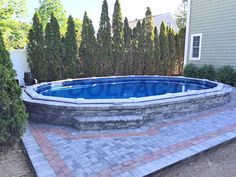 This beautiful Intrepid model pool was installed semi inground and surrounded with brick to cover the frame. #thepoolfactory