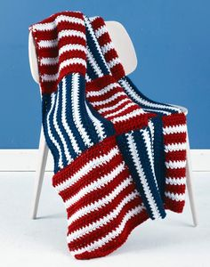 USA Afghan ~ Fly your colors with the USA afghan! You can make an American flag themed blanket to keep cozy while supporting your country. Whether you plan on rooting for the United States this winter or plan on using this as a throw for the 4th of July, you'll love how quickly this pattern works up out of light and comfortable Lion Brand Hometown USA yarn.