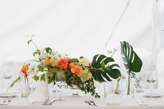 We wouldn't have big centerpieces like this, but you can see here some of the vases and candles I would be using.