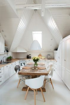 Bright white kitchen + dining room