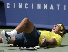 Victory: Nadal falls to the ground after beating Isner in the final of the Cincinnati Masters