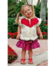 This cozy layer is as sweet as can be with a lovable heart design and fun, loopy trim. It zips on with ease to keep little cuties cuddled in comfort throughout the day. Even better, 10 percent of the proceeds from this item will go to the National Down Syndrome Society.