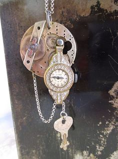 A personal favorite from my Etsy shop https://www.etsy.com/listing/387200626/steampunk-antique-watchpart-pendant
