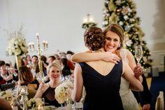 Bride hugs maid of honor after heartfelt toast