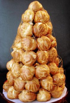A croquenbouche is a tower of caramel glazed cream puffs. A delicious showstopping dessert!