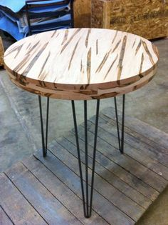 Reclaimed round ambrosia maple table. Triple stack edges with hairpin legs.