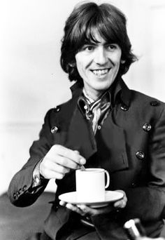 George drinking tea.  OK, it's not a beautiful tea setting, but he did have a beautiful smile.