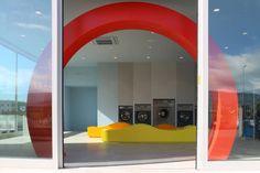SUPERplum · EASY WASH - landscape Cortona red circle yellow orange blu grey washing machine