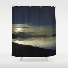 Calm sunset at the lake. After de storm. Shower Curtain by Guido Montañés - $68.00