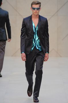 Men's Summer Fashion- Burberry Prorsum 2013. Pair a dark suit with a bright pop of color undershirt! Can't go wrong!