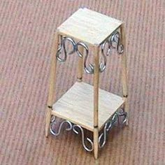 miniature plant stand...(looks like toothpicks and balsa wood squares...and metal S hooks from hardware store! I would use wood skewers when upsizing to 1:6 scale ~ kj)