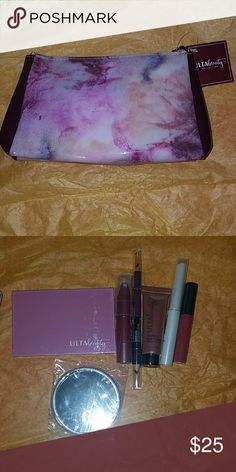 Brand New Ulta Beauty Set with makeup Brand New Ulta Beauty Setwith Makeup has a small palete and mirror with other makeup items as shown makeup bag is purple If Purchased Todaybefore 3  will Shiptoday or tommorrow ulta beauty Makeup