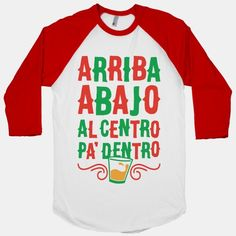 """This cute Mexican party shirt features a shot glass and the famous Spanish toast """"arriba abajo al centro pa' dentro"""" and is perfect for drinking on Cinco de Mayo, celebrating your Mexican heritage,...   Beautiful Designs on Graphic Tees, Tanks and Long Sleeve Shirts with New Items Every Day. Satisfaction Guaranteed. Easy Returns."""