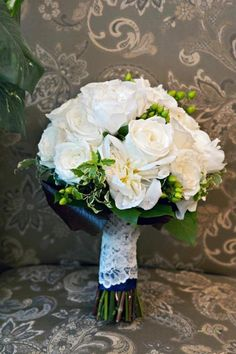 Bridal Bouquet. White Roses & Racunulus & green hypericum berries. Lace from mother's veil around stems
