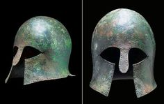 Corinthian helmet, circa early 6th century B.C. Of domed form with flaring flange at rear, the nose-guard with rounded end, pierced with multiple holes around the perimeter, the crown pierced twice with twin holes for attachment of crest, 19.6 cm high. Private collection, from Christie's auction