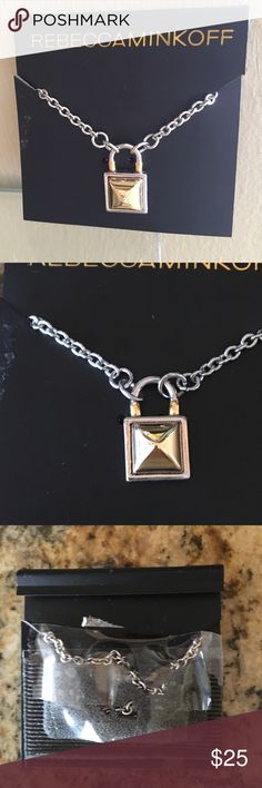 """Rebecca Minkoff Lock Pendant Necklace Rebecca Minkoff brand new on card silver and gold tone lock Pendant necklace on silver chain. Chain adjustable to 20"""". See pic 4 for size is Pendant. Rebecca Minkoff Jewelry Necklaces"""
