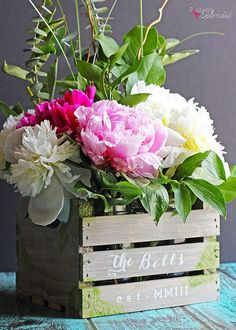 This rustic wood crate centerpiece would be perfect for a laid-back outdoor wedding. This simple, budget-friendly decoration is made by dressing up an unfinished wooden crate, a coat of paint, and a few mason jars to hold the flower arrangement. It will double as a beautiful personalized home decor item after the big day!