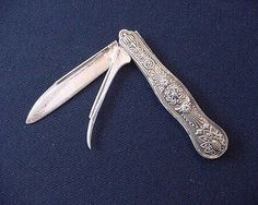 """Fruit Knife - Before the dawn of expedited cross-country shipping, fruit was considered a luxury. Men carried these fruit pocket knives to display their economic stature.  Victorian Sterling Folding Fruit Knife, 6–7"""" in length; sold for $100."""