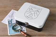 Adventure Awaits Keepsake Box - Store art supplies, photographs and travel memorabilia in these trusty tins, complete with a durable clasp to keep your memories safe. A black emblem filled with mountains and evergreens beckons you to get outside. Tin Boxes, Art Store, Adventure Awaits, Keepsake Boxes, Art Supplies, Decorative Boxes, Photographs, Studio, Tins