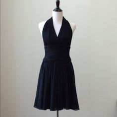 """Black Chiffon Halter-like Dress Size 8 A.J. Bari black chiffon halter-like dress size 8. Beautiful & sexy cocktail, knee-length dress in great condition (I just had it dry cleaned).   Closures on back: 3 hook & eye closures top center, 1 hook & eye closure mid-section center & zipper closure.   Gathered waist band with a full flowing skirt.   Approx measurements: 34"""" bust, 29"""" waist, 41.5"""" length (measuring from top of halter area).   100% Polyester.   Such a Marilyn Monroe dress!   Able to…"""