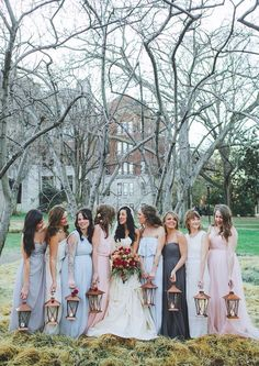 Bridesmaids light the way with lanterns instead of carrying bouquets