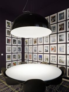 Art wall: white frames and matting on a dark wall